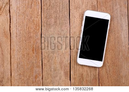 blank screen white smartphone on wooden background