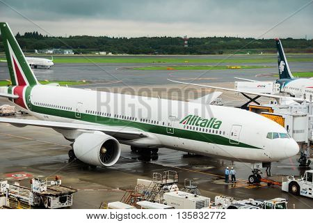 TOKYO, JAPAN - circa JUNE 2016: Alitalia aircraft Boeing 777 towed at Narita International Airport, Japan. Alitalia is the flag carrier and national airline of Italy.