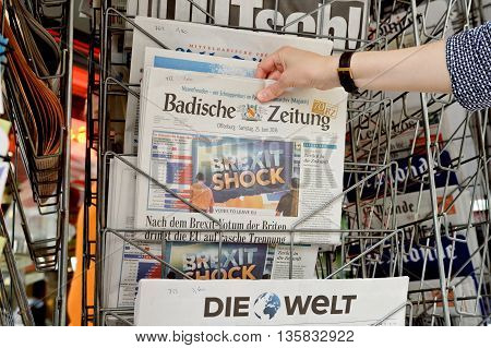 Woman Buying Badische Zeitung Newspaper With Shocking Headline About Brexit