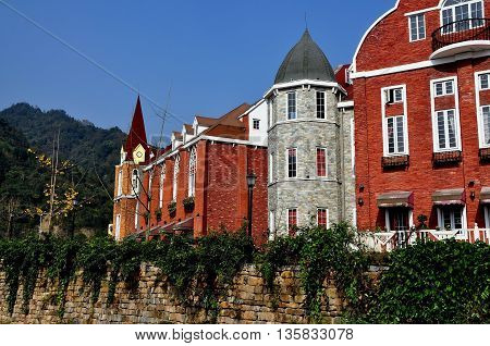 Bai Lu China - November 17 2013: Handsome brick and stone French-style buildings in the Sino-French Village built following the 2008 earthquake