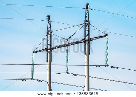 High-voltage Power Lines In A Field On A Summer Day