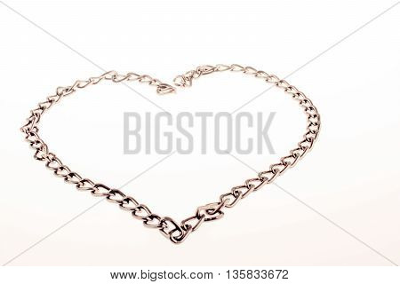 Chain forms a heart shape on a white background