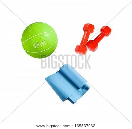 The set of sport accessories for fitness, yoga, bodybuilding and weight loss. Medicine ball, resistance band and dumbbells isolated