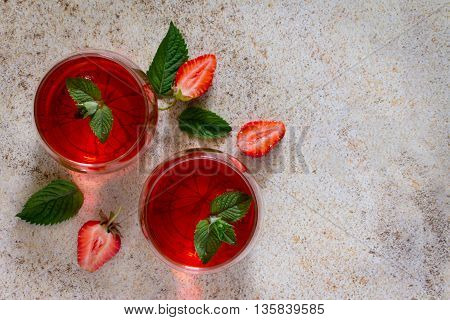 Tradition Summer Juice Drink With Strawberries And Mint With Copy Space On The Stone Background.