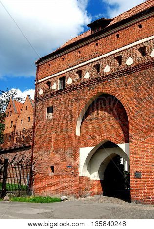 Torun Poland - May 25 2010: 15th century Boatman's Gate city entrance through the medieval defense walls