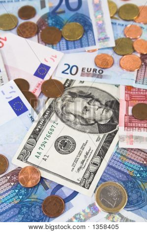 Euro And Dollar Bills And Coins