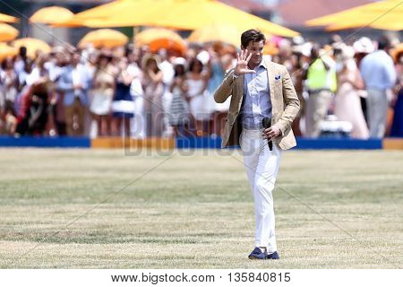 JERSEY CITY, NJ-MAY 30: Actor Andrew Rannells waves to the crowd after singing the National Anthem at the Annual Veuve Clicquot Polo Classic at Liberty State Park on May 30, 2015 in Jersey City, NJ.