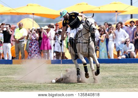 JERSEY CITY, NJ-MAY 30: Rico Mansur handles the ball during a polo match at the 8th Annual Veuve Clicquot Polo Classic at Liberty State Park on May 30, 2015 in Jersey City, NJ.