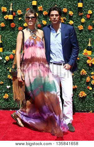 JERSEY CITY, NJ - MAY 30: Delfina Blaquier (L) and Nacho Figueras attends the 8th Annual Veuve Clicquot Polo Classic at Liberty State Park on May 30, 2015 in Jersey  City, New Jersey.