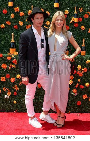 JERSEY CITY, NJ - MAY 30: Models Ben Mills (L) and Megan Irwin attend the 8th Annual Veuve Clicquot Polo Classic at Liberty State Park on May 30, 2015 in Jersey  City, New Jersey.