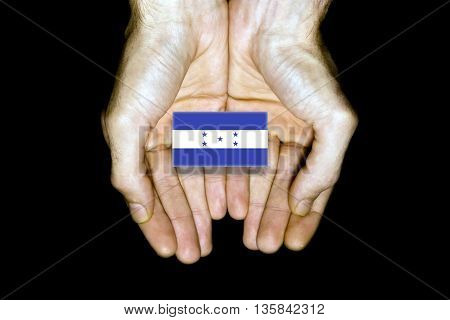 Flag Of Honduras In Hands On Black Background