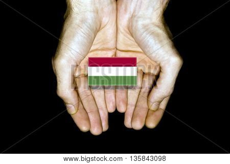 Flag Of Hungary In Hands On Black Background