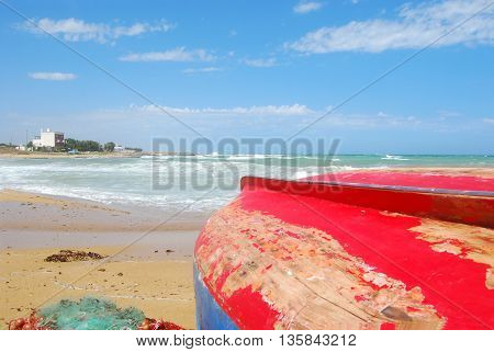 Boats pulled ashore on the coast of Apulia Torre Canne - Puglia - Italy