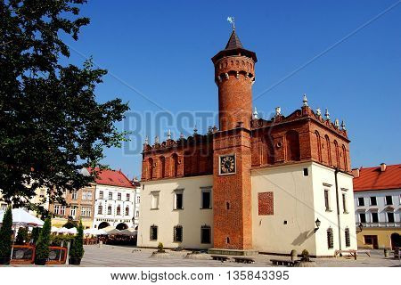 Tarnow Poland - June 12 2010: Renaissance Ratusz (Town Hall) with  medieval tower sits in the center of the old Rynek Market Square