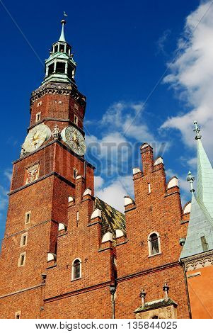 Wroclaw Poland - June 13 2010: Bell-Clock tower and brick gables of the late 15th to early 16th century Ratusz (Town Hall)