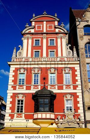 Wroclaw Poland - May 13 2010: Coral-coloured baroque burgher's house in the Rynek old market square