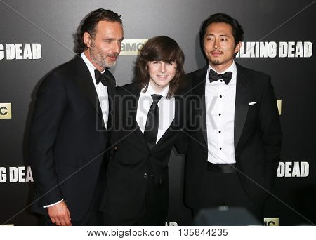 NEW YORK-OCT 9: (L-R) Actors Andrew Lincoln, Chandler Riggs and Steven Yeun attend AMC's 'The Walking Dead' season six premiere at Madison Square Garden on October 9, 2015 in New York City.