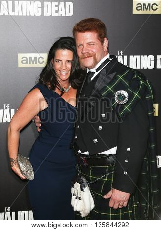 NEW YORK-OCT 9: Actor Michael Cudlitz (R) and Rachel Cudlitz attend AMC's 'The Walking Dead' season six premiere at Madison Square Garden on October 9, 2015 in New York City.