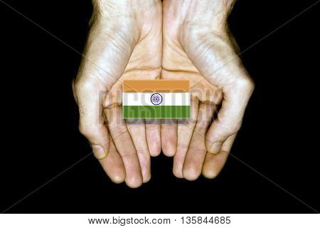 Flag Of India In Hands On Black Background