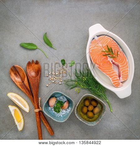 Raw Salmon Fillet In The White Bowl With Ingredients Olive Oil ,sea Salt, And Herbs  Fennel ,sage ,r