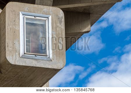 Detail of a Brutalist building with a window