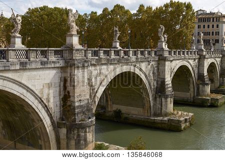ROME ITALY - SEPTEMBER 28 2010: Tourists Crossing the Bridge In Front Of Castel Sant'Angelo in Rome Italy