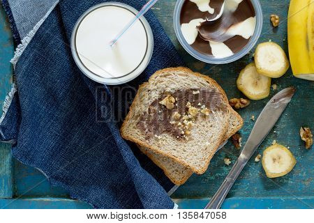 Cooked Breakfast With Toast Bread, Chocolate Cream Butter And A Glass Of Milk, Top View.