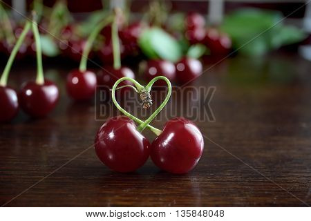 Sweet red cherries on a wooden table