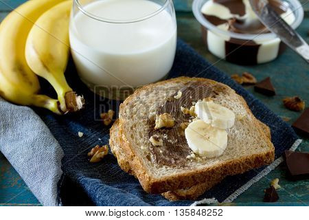 Cooked Breakfast With Toast Bread, Chocolate Cream Butter And A Glass Of Milk On Vintage Background