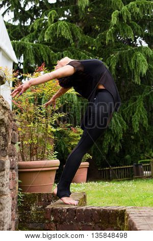 A beautiful young jazz dancer performing outdoors
