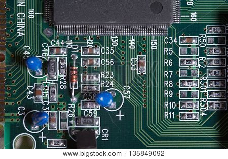 Printed board of computer component with electronic elements closeup