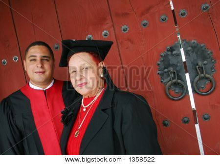 University Graduate In Robes With His Grandmother