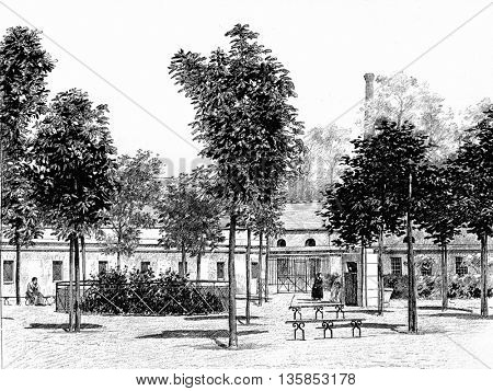 Mental facility at the Pitie-Salpetriere Hospital in Paris, France. Vintage engraving. Holding place for the mentally disabled, criminally insane, epileptics, and the poor.