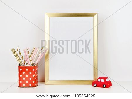 Gold frame mock up and toy red car, vase red and polka dots pattern. vintage
