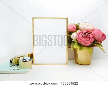 Gold frame mock-up and white wall with gold vase and peonies Place work