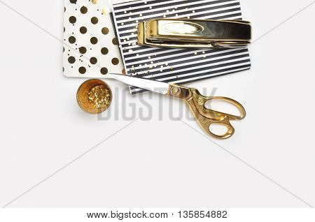Mockup background. Header website or Hero website, Mockup product view table gold accessories. stationery supplies. glamour style. Gold stapler.