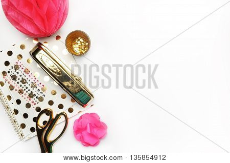 Flat lay, gold stationery on white table, notebook and stapler, woman style, desktop modern
