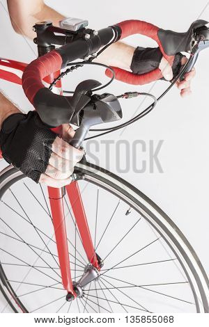 Closeup of Athlete Hands in Gloves Holding Dual Controls Levers. Vertical Image