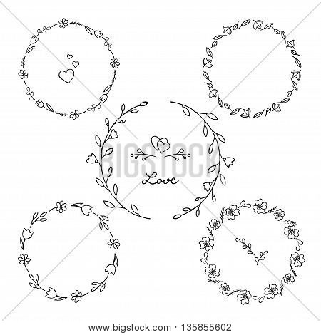 Set of floral circular frames. Graceful wreaths of wild flowers and leaves. Black and white illustration.