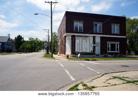 JOLIET, ILLINOIS / UNITED STATES - JUNE 3, 2015: A building with a vacant storefront, now used as the Stepping Stones Inc. Men's Recovery Home.