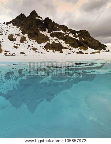 Frozen Lake Reflecting Snowy Ingalls Peak.  Ingalls Lake, Alpine Lakes Wilderness, Washington