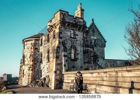 Girl In Front Of A Small Castle In Edinburgh, Scotland