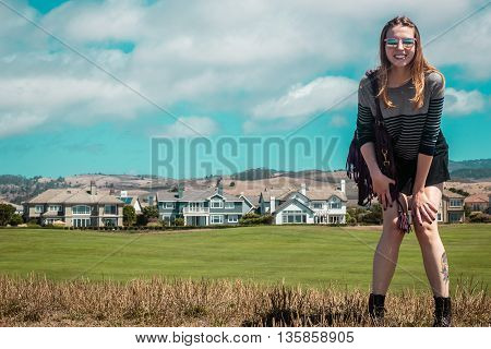 Girl In Front Of Houses Near Half Moon Bay In California