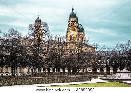 Photo of Munich building and trees in a cloudy day