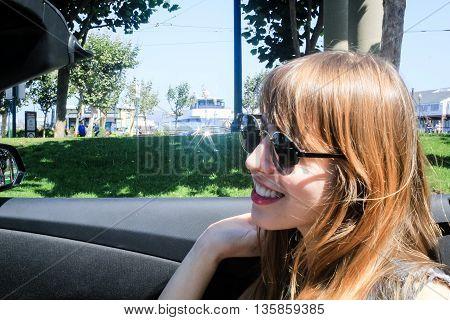 Young Girl In A Convertible At San Francisco, California