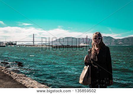 Girl In In Front Of Golden Gate Bridge In San Francisco, California