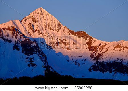 Pink Sunset Illuminates Snowy Wilson Peak.  The San Juan Range, Rocky Mountains, Colorado, USA.