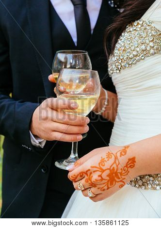 Bride and groom with glasses of champagne glasses of champagne