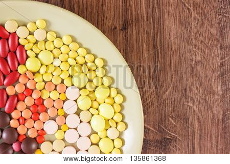 Colorful Medical Pills, Tablets And Capsules On Plate, Health Care Concept, Copy Space For Text