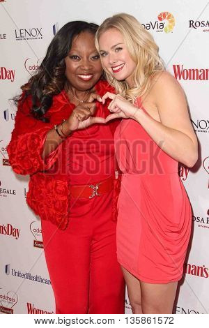 NEW YORK-FEB 10, 2015: TV personality Star Jones (L) and actress Laura Bell Bundy attend the 12th Annual Woman's Day Red Dress Awards at Jazz at Lincoln Center on February 10, 2015 in New York City.